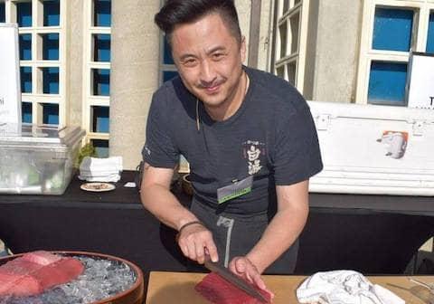Volunteer helping prepare food at SOS Meals on Wheels