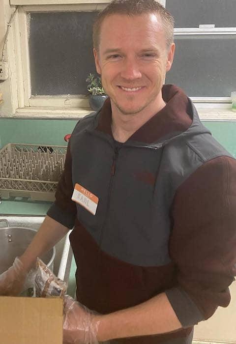 Karl volunteering at Eastoakland Burrito Roll
