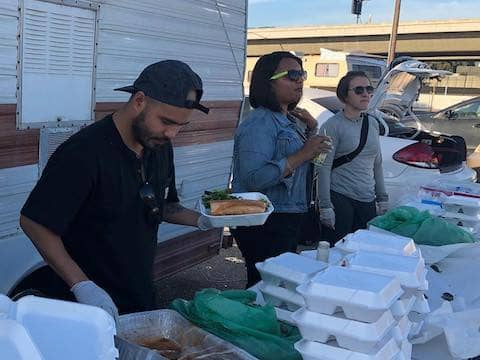 Volunteers distributing food at Eastoakland Burrito Roll