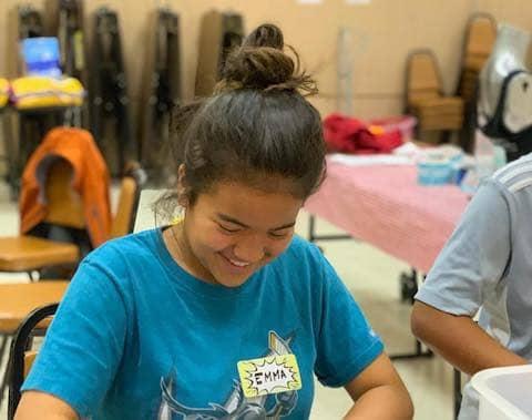 Emma volunteering at Eastoakland Burrito Roll
