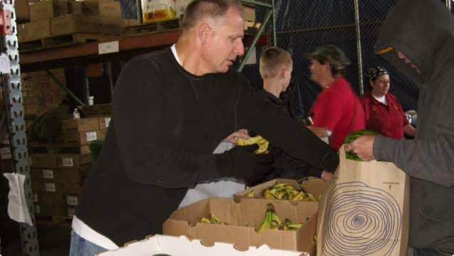 Volunteer at Alameda Food Bank pop-up pantry