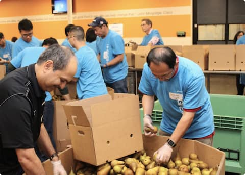 Volunteers sorting food at Second Harvest of Silicon Valley