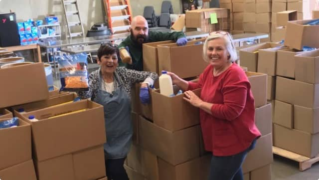 CANV team sorting food in the warehouse