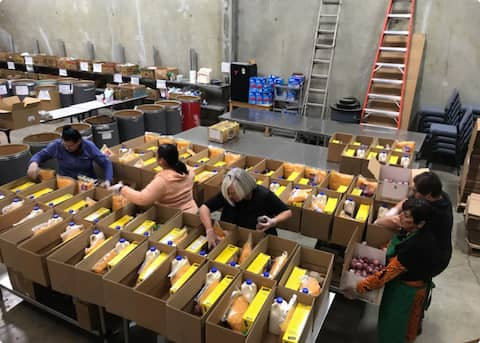 Community Action of Napa Valley team sorting food in the warehouse