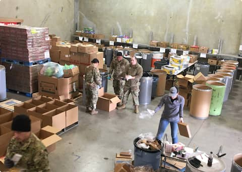 Volunteers helping in the warehouse at Community Action of Napa Valley