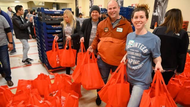 Volunteers helping to distribute food to the community at Glide