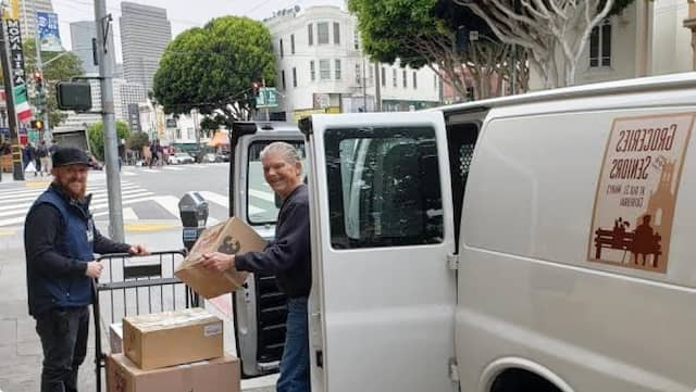 Toby and Tom loading bounty into trusty GFS Delivery Van