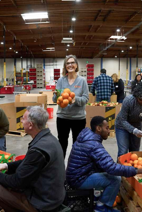 Suzan Bateson (center), executive director of the Alameda County Community Food Bank