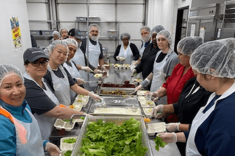 Swinerton volunteers packing meals for SOS Meals on Wheels