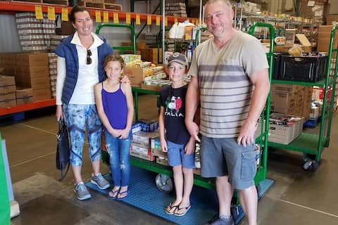 The Claussen family dropped by the Redwood Empire Food Bank and donated 248 pounds of food — purchased with their allowance money (and a little help from Mom and Dad)