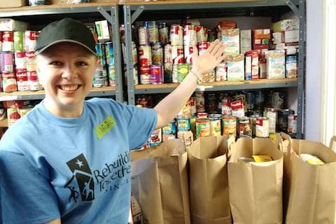Abigail with Pacifica Resource Center packed emergency food bags