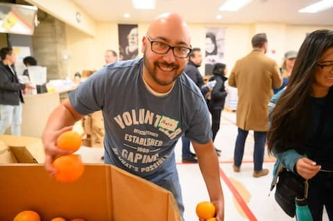Mario volunteers at GLIDE Grocery Bag Giveaway