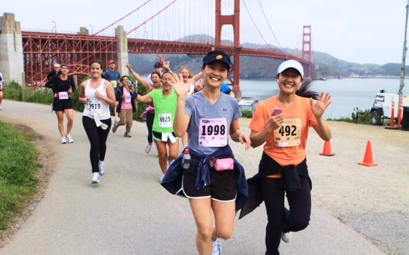 Volunteers at running marathon (by Edgewood Center)