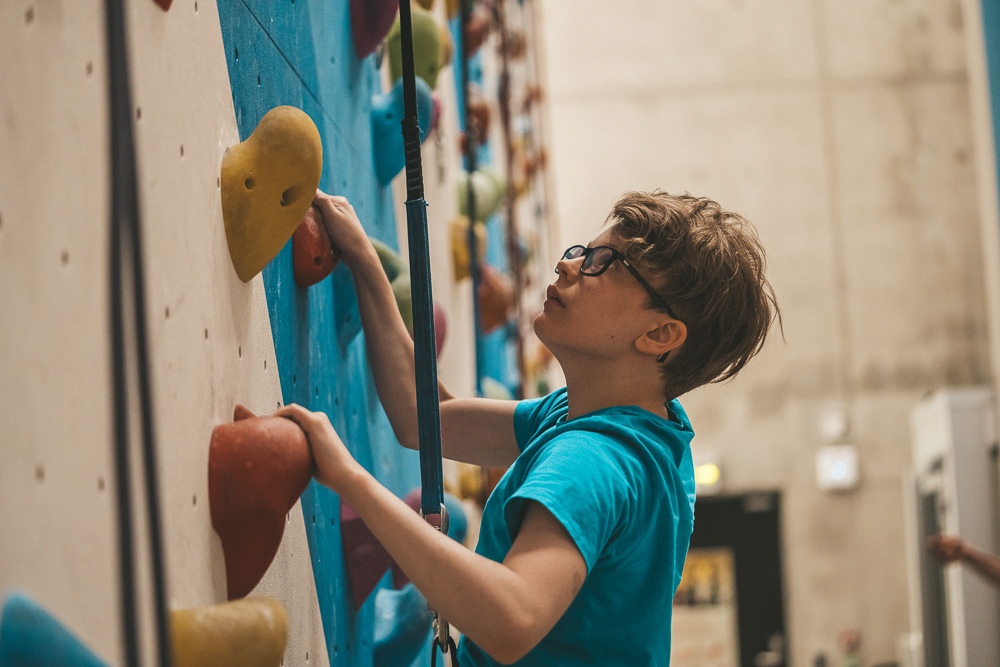Boy climbing in a climbing hall