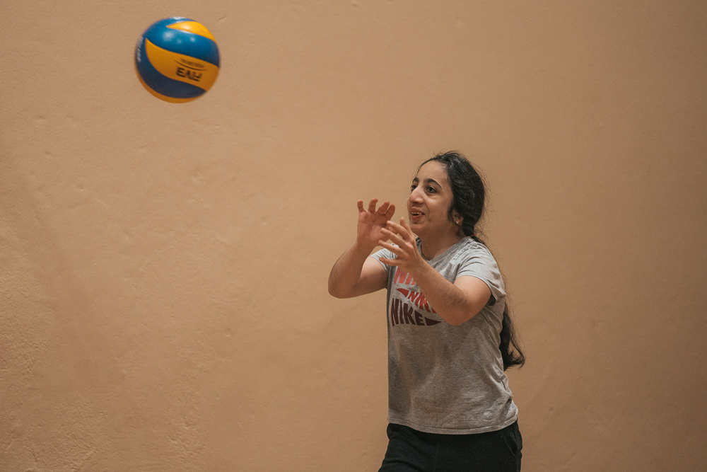 Girl throwing a volleyball