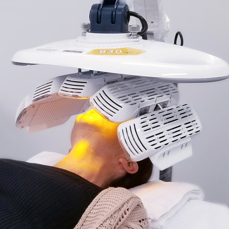 LED red light phototherapy applied to a woman's face