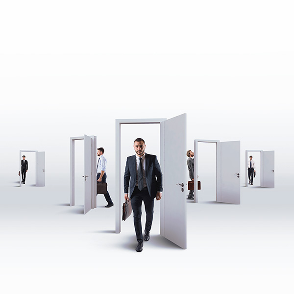 photo: business men walking through open door frames