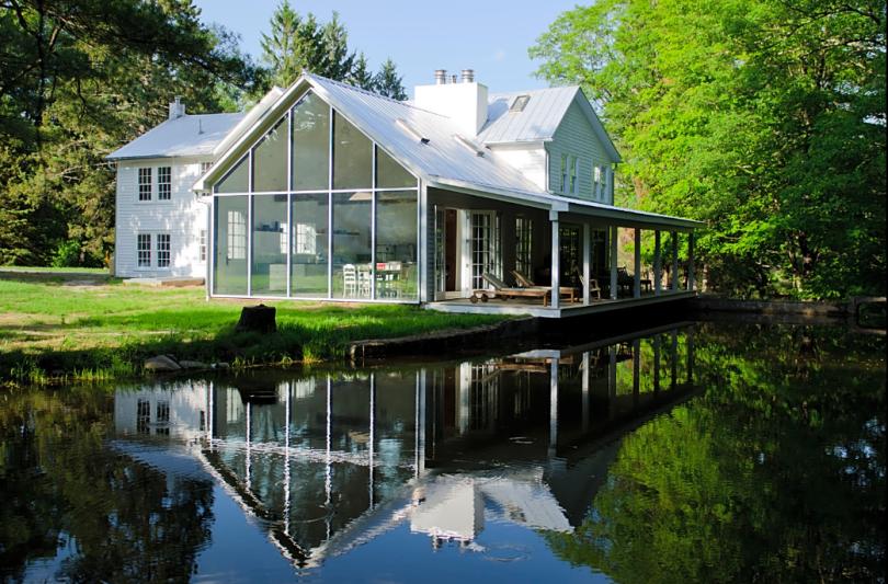 glass house on lake