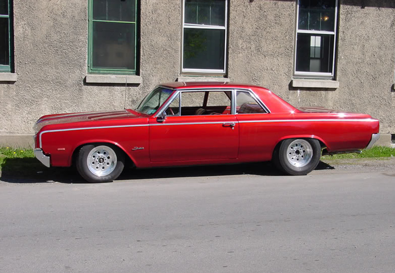 My red 1964 Oldsmobile F-85 drivers side profile