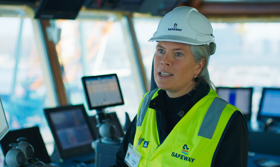 Picture of Suzanne Hordijk with helmet onboard of ship