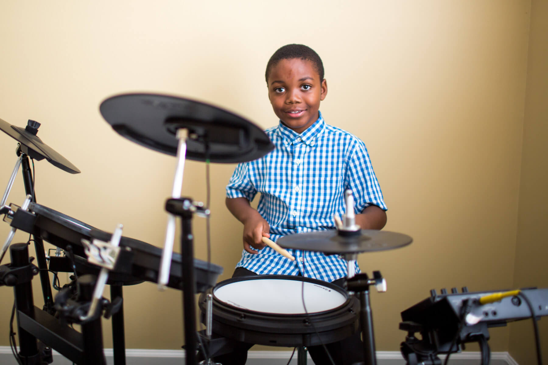 Student playing drums.