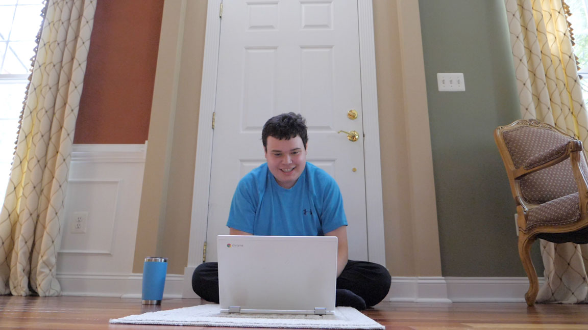 Still from the documentary of Kyle on the computer.