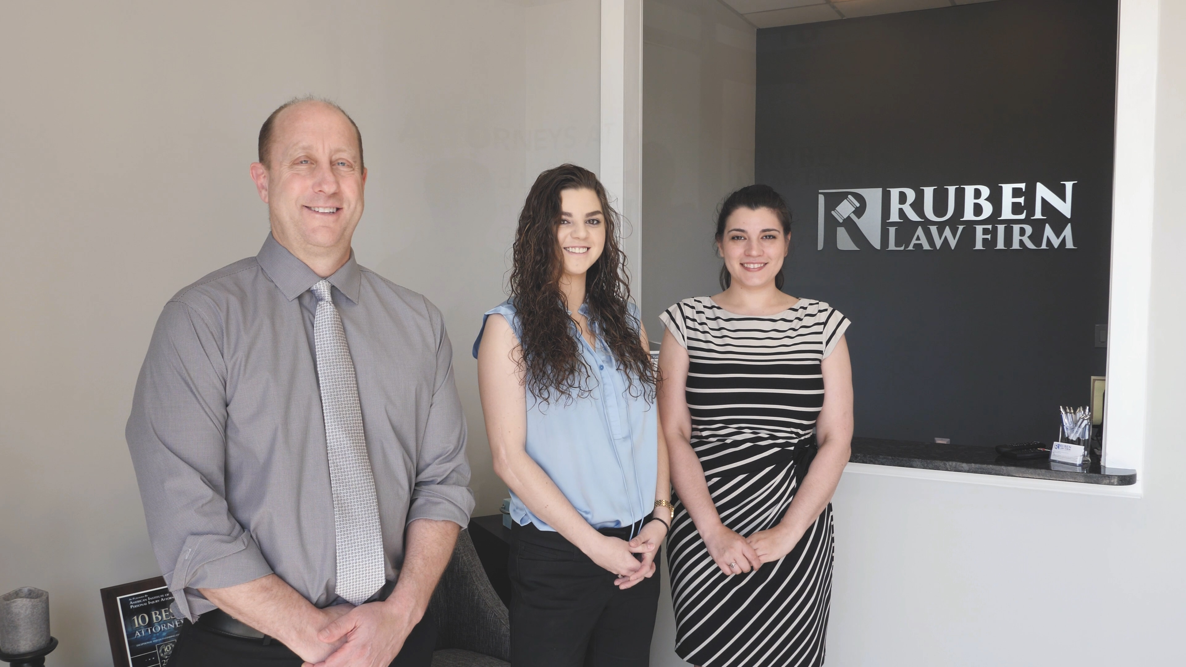 The Ruben Law Firm team in the newly opened office.