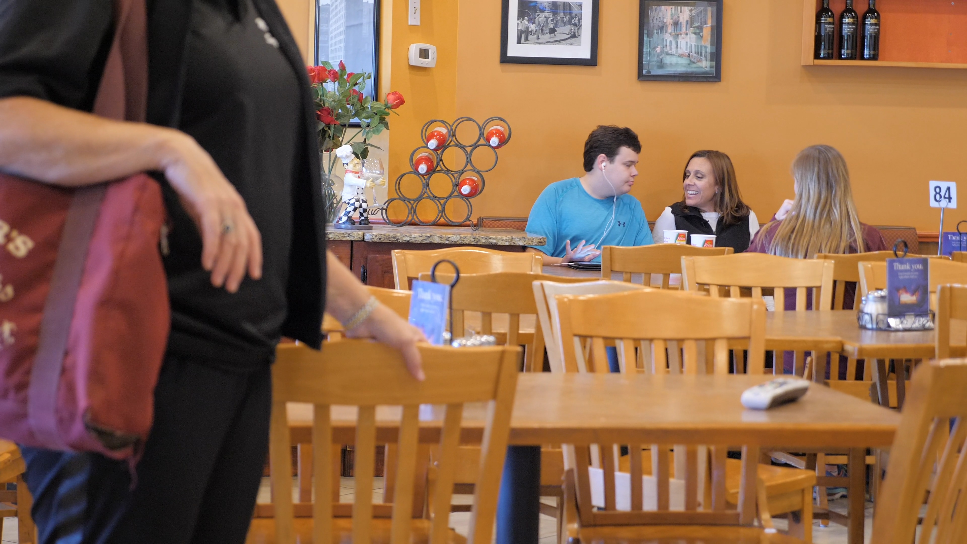 Still from the documentary of Kyle and family at lunch.