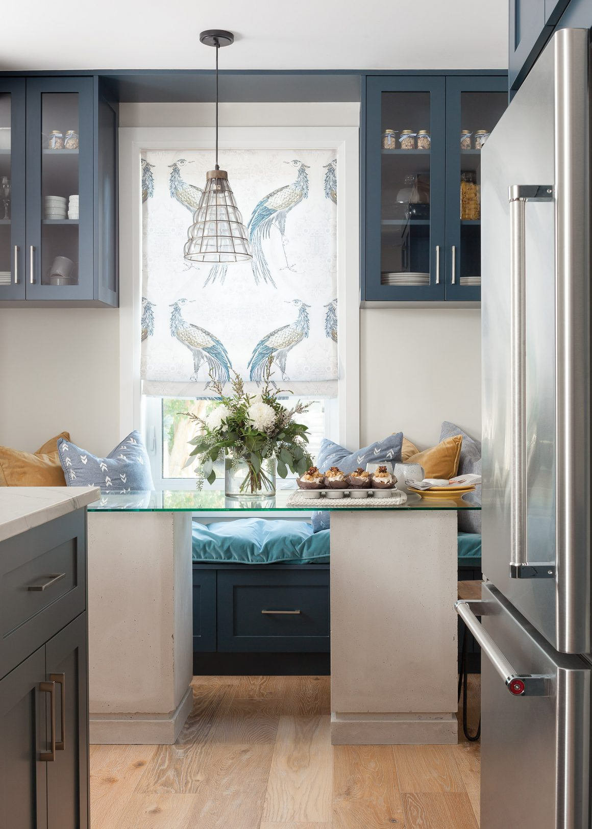 Blue kitchen and glass table