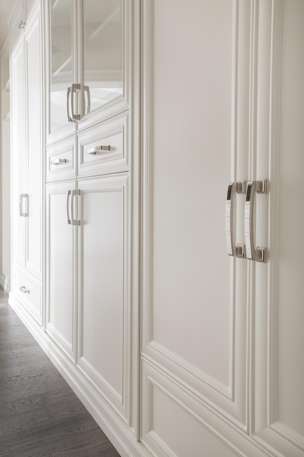 White cabinets with silver handles