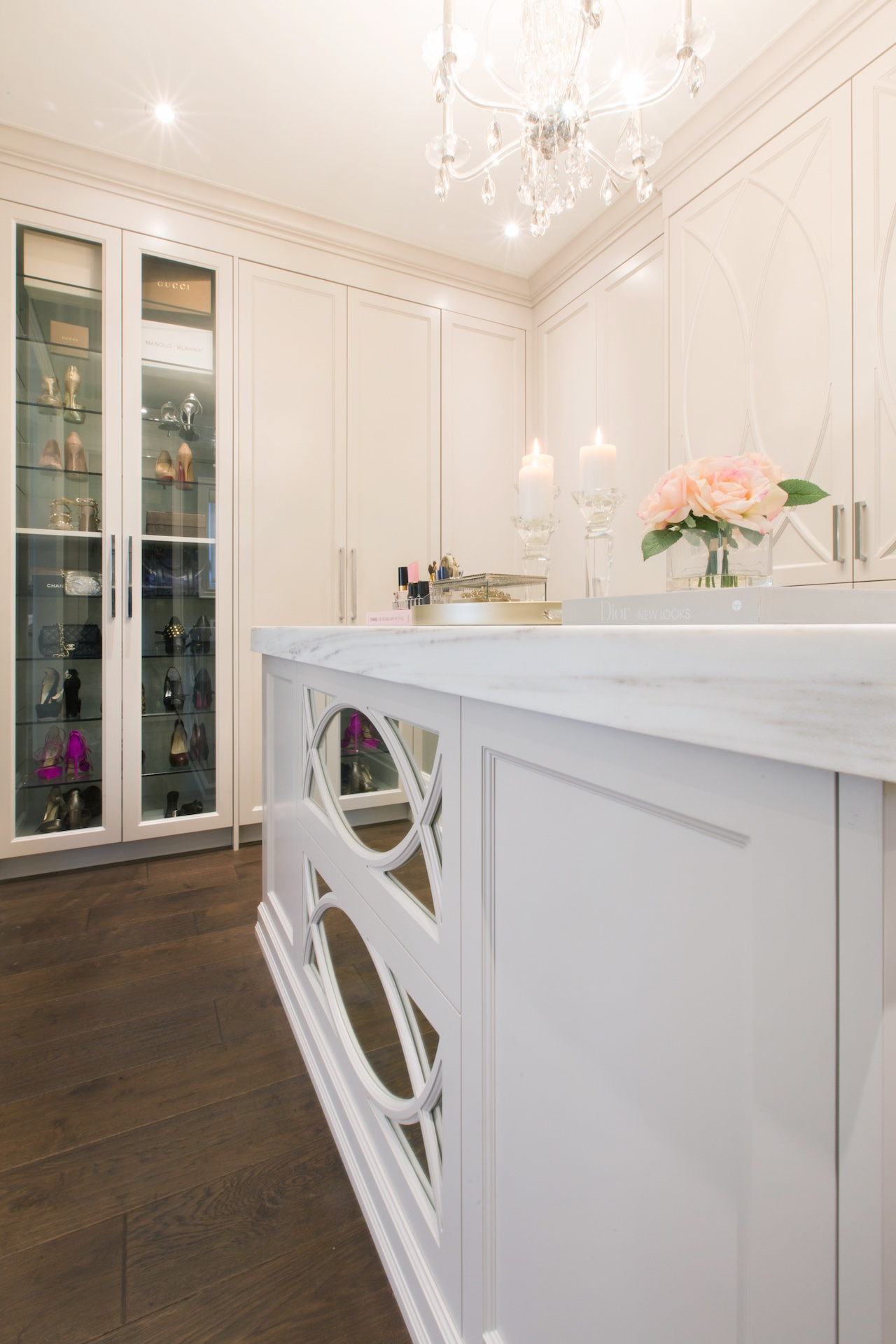 cabinet with glass doors and island