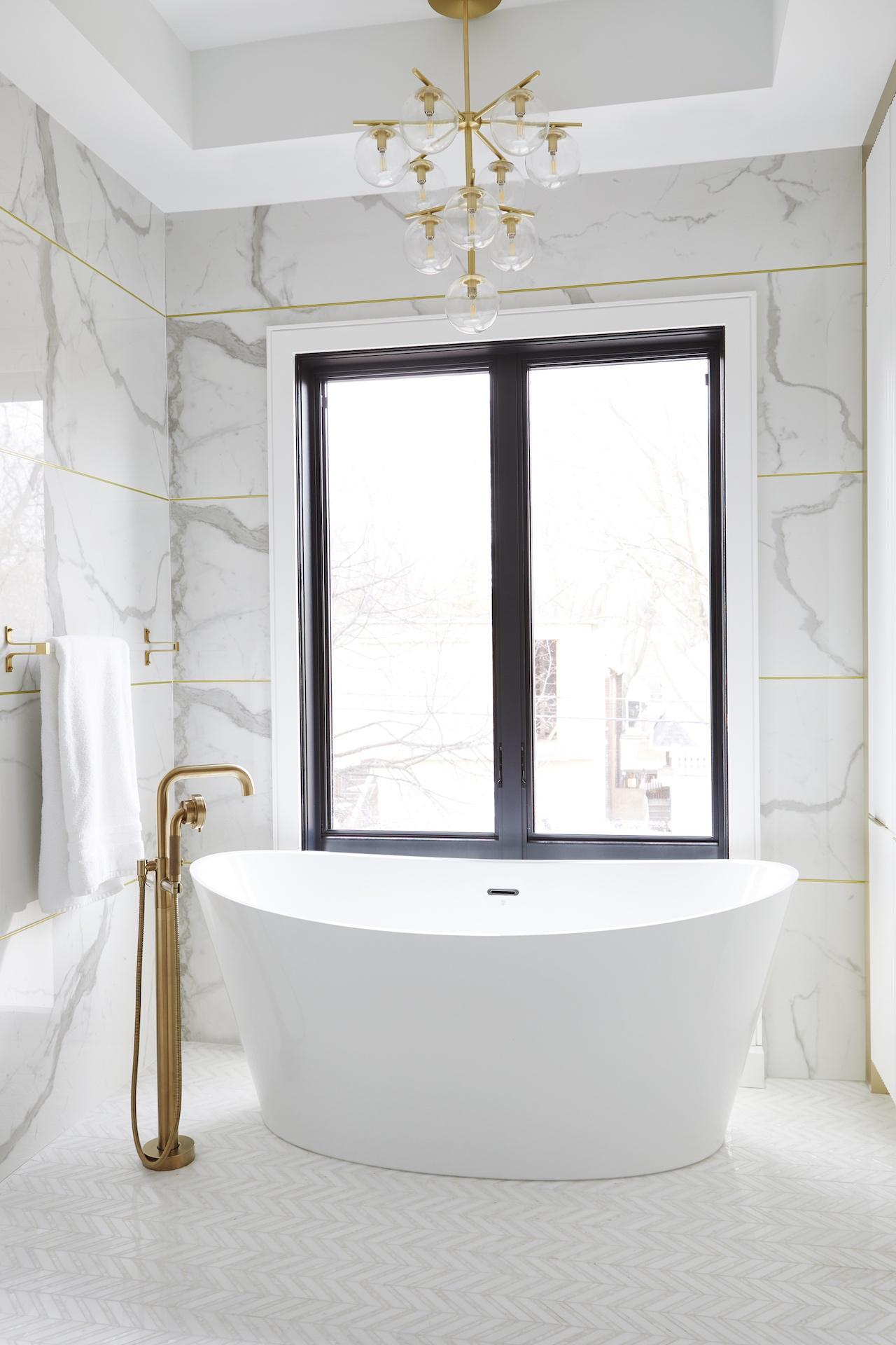 white bath tub under gold light