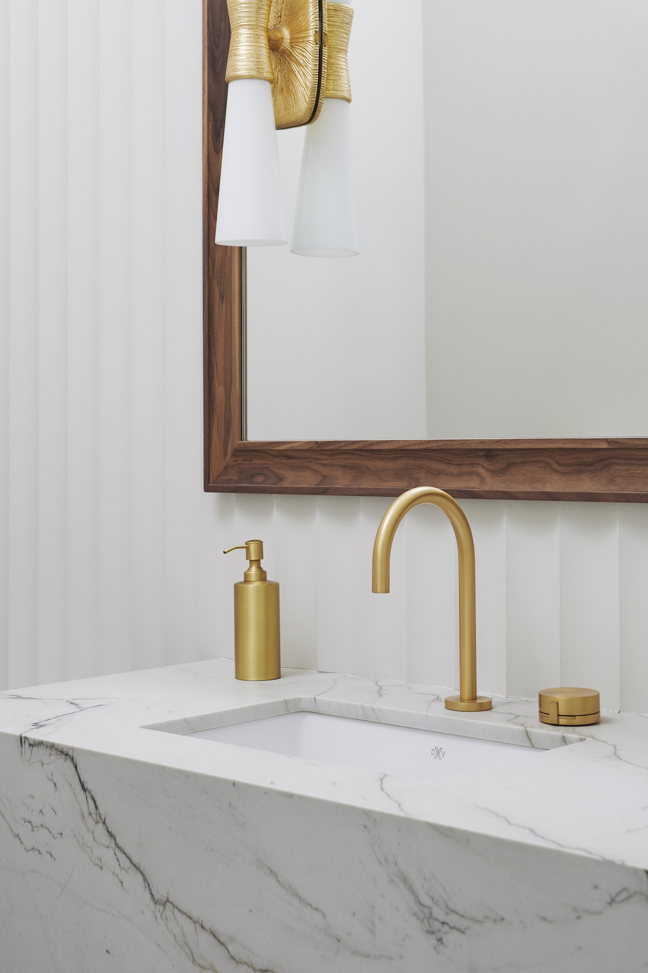 marble sink with gold faucet