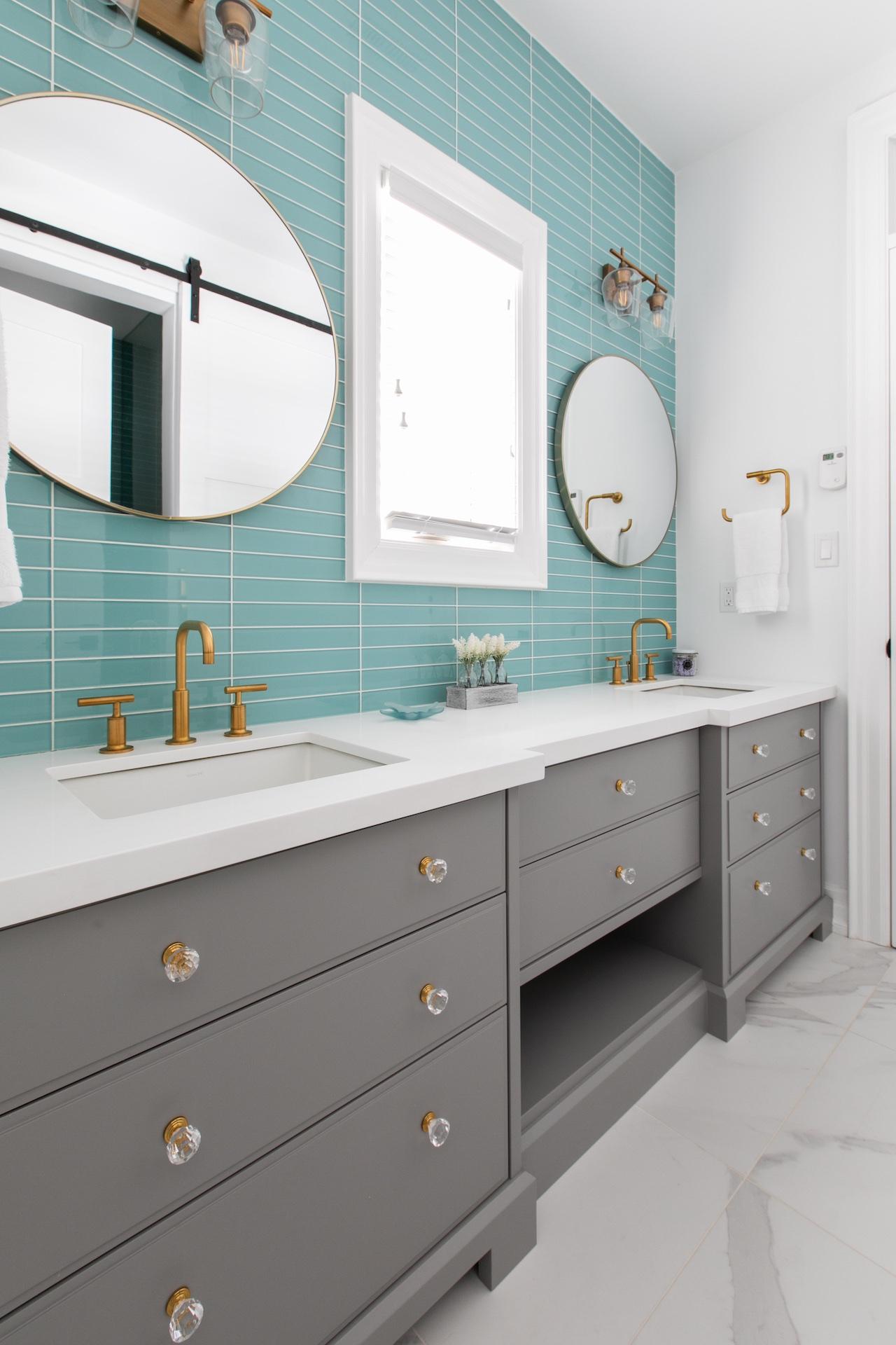 grey vanity drawers and green backsplash