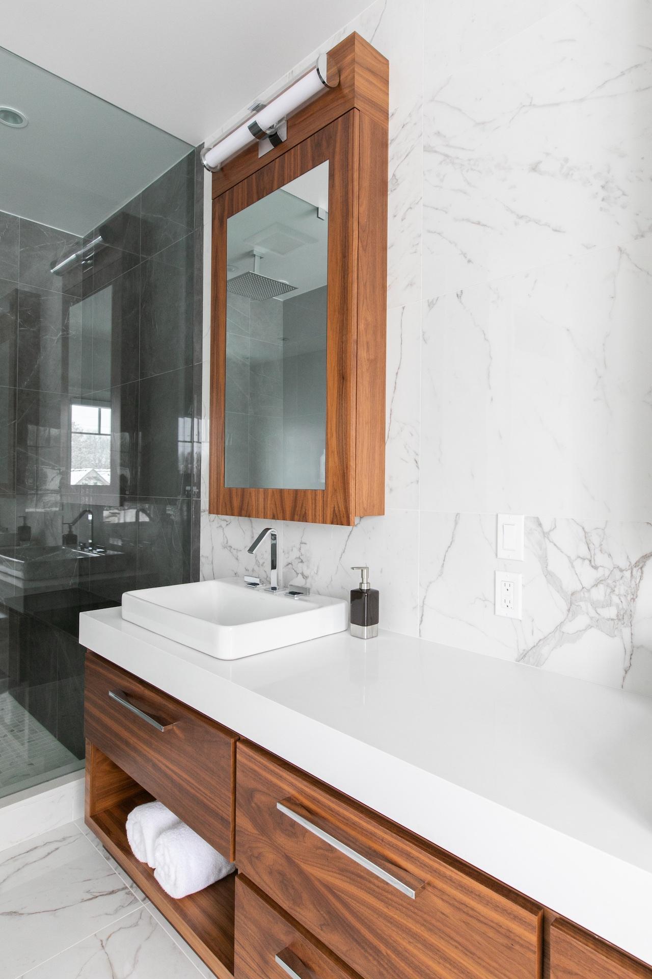 wood vanity drawers and white sink