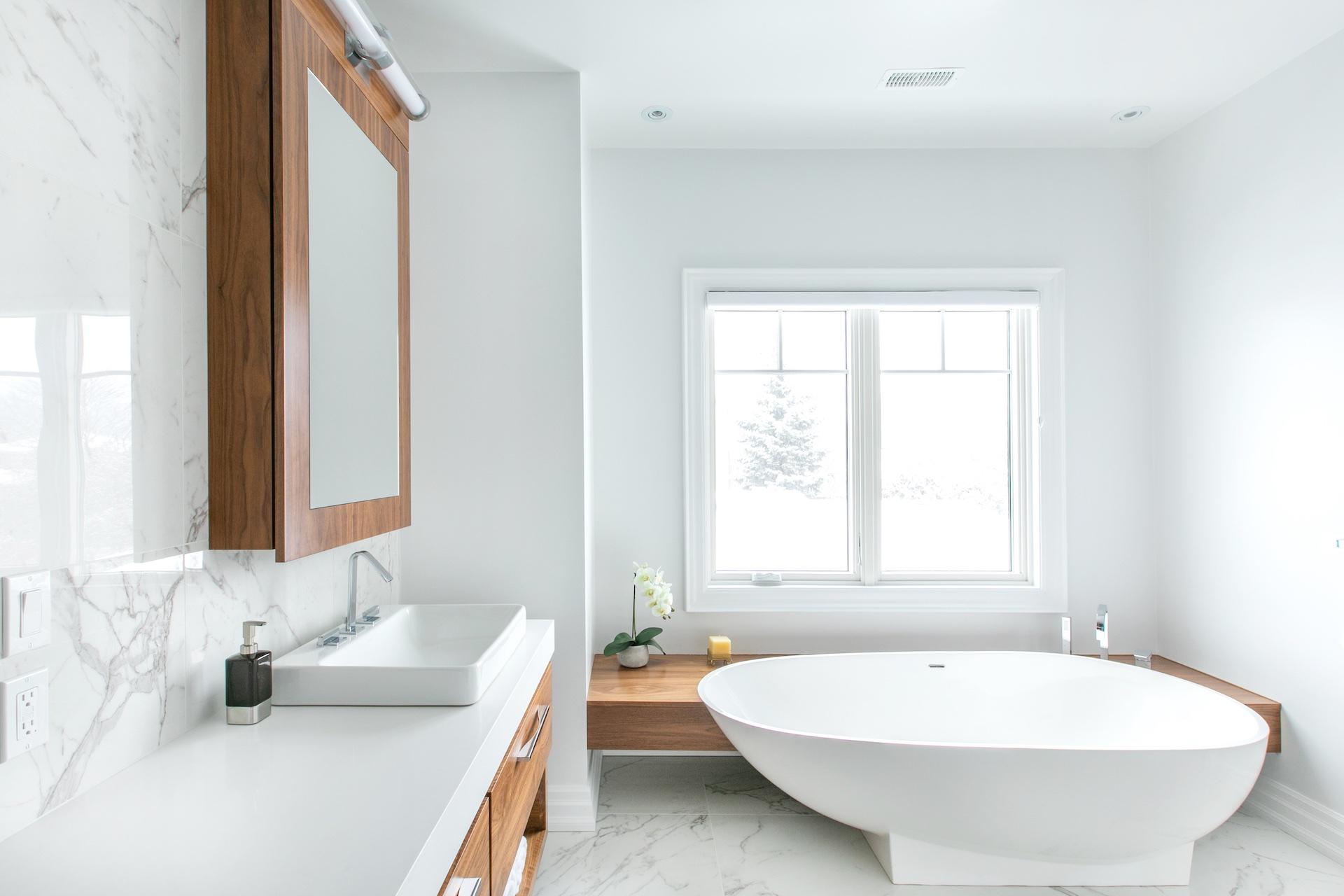 white tub under window