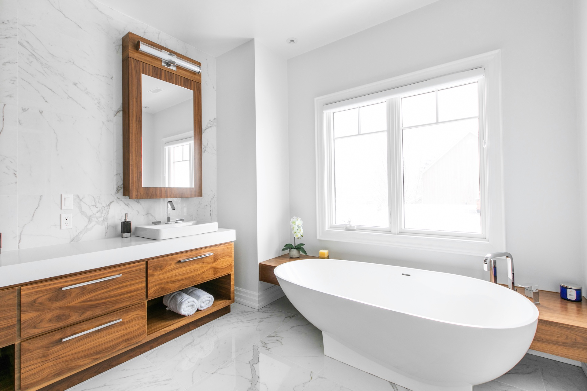 wood vanity and white bath tub