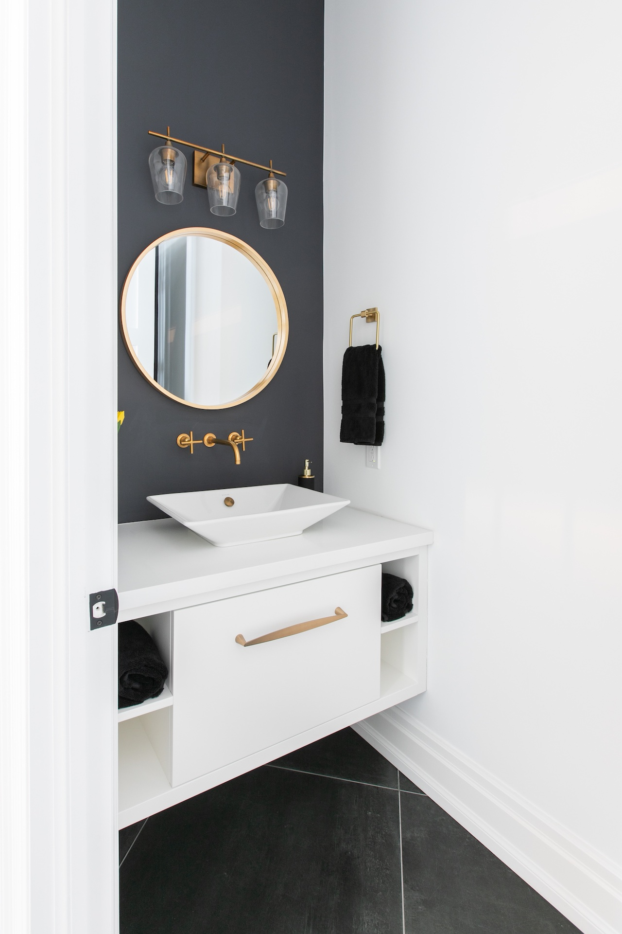 white vanity with gold mirror