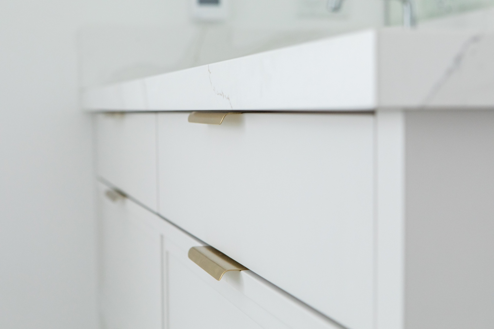 white drawer with gold handles