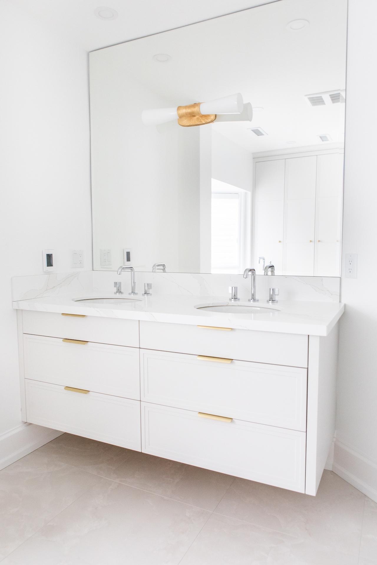 white bath vanity and mirror