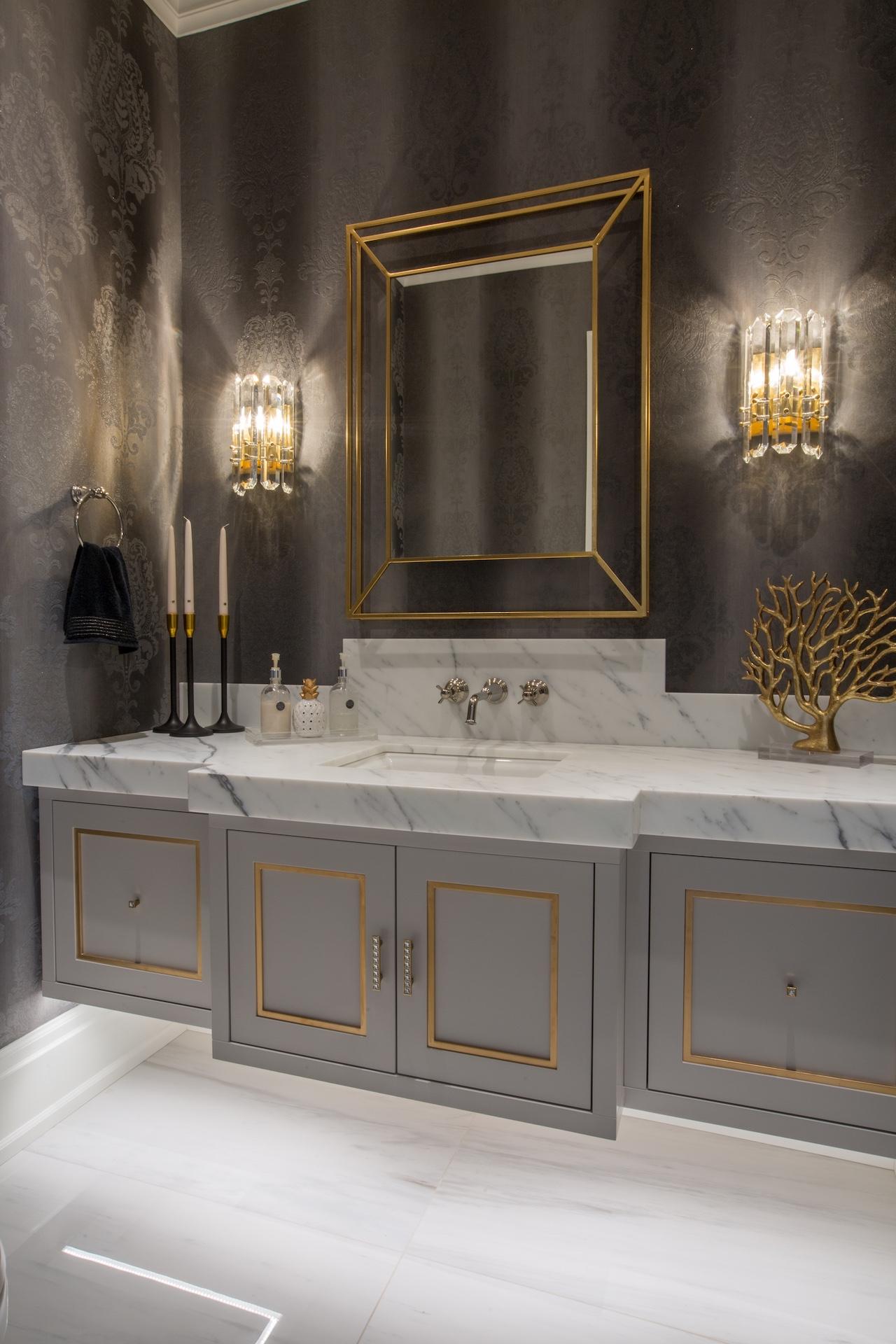 bathroom grey vanity with gold mirror