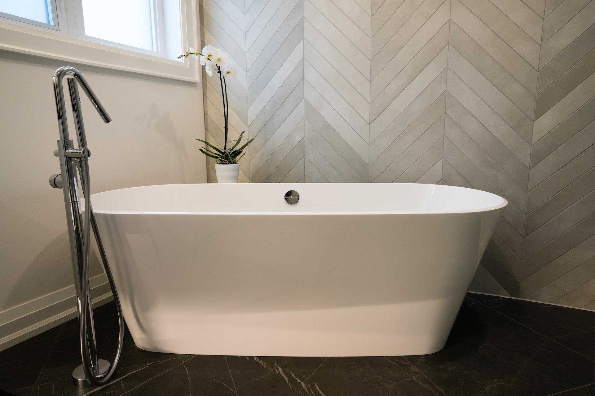 white tub with wood backing