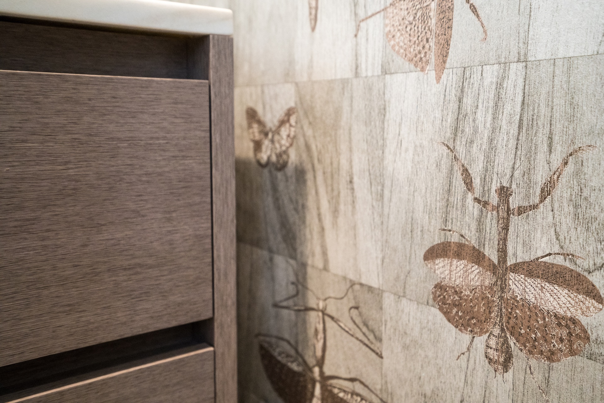 grey wallpaper and wood vanity