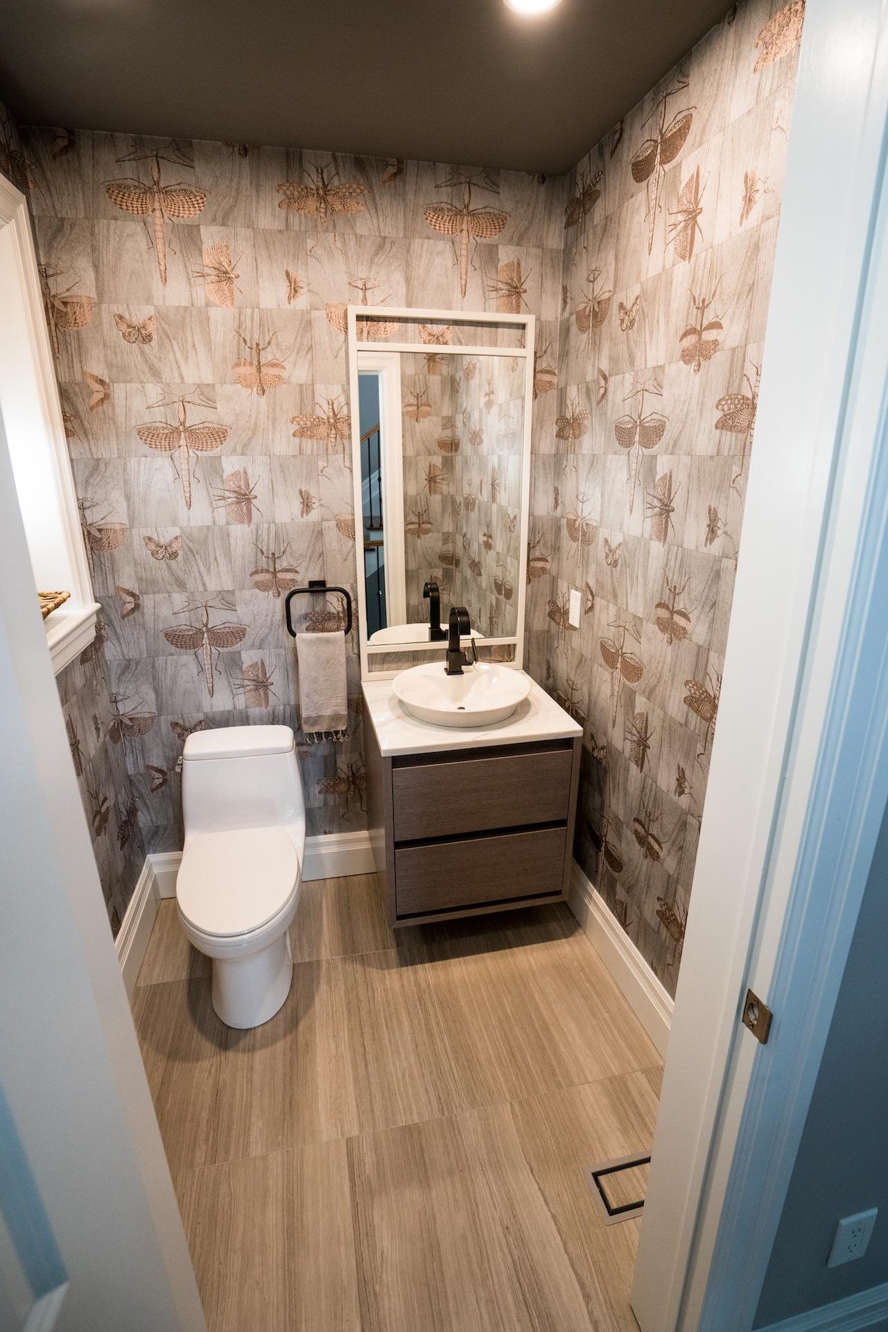 bathroom with wood floor and wallpaper