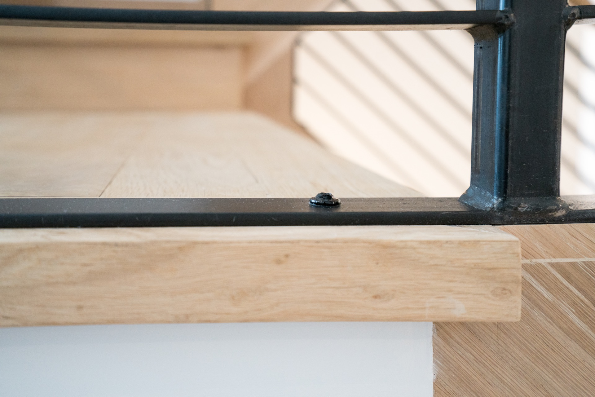Wood stairs with black railings