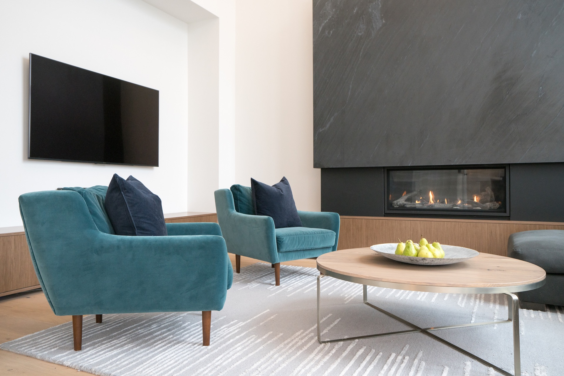 Green chairs and wood coffee table