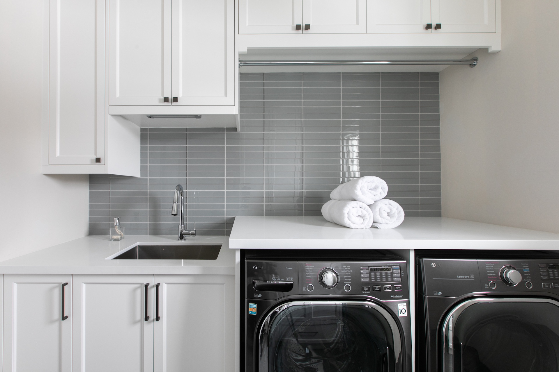 Laundry room cabinets with washer/dryer
