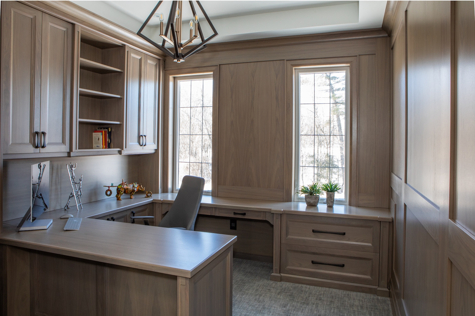 dark wood office with matching desk and cabinets