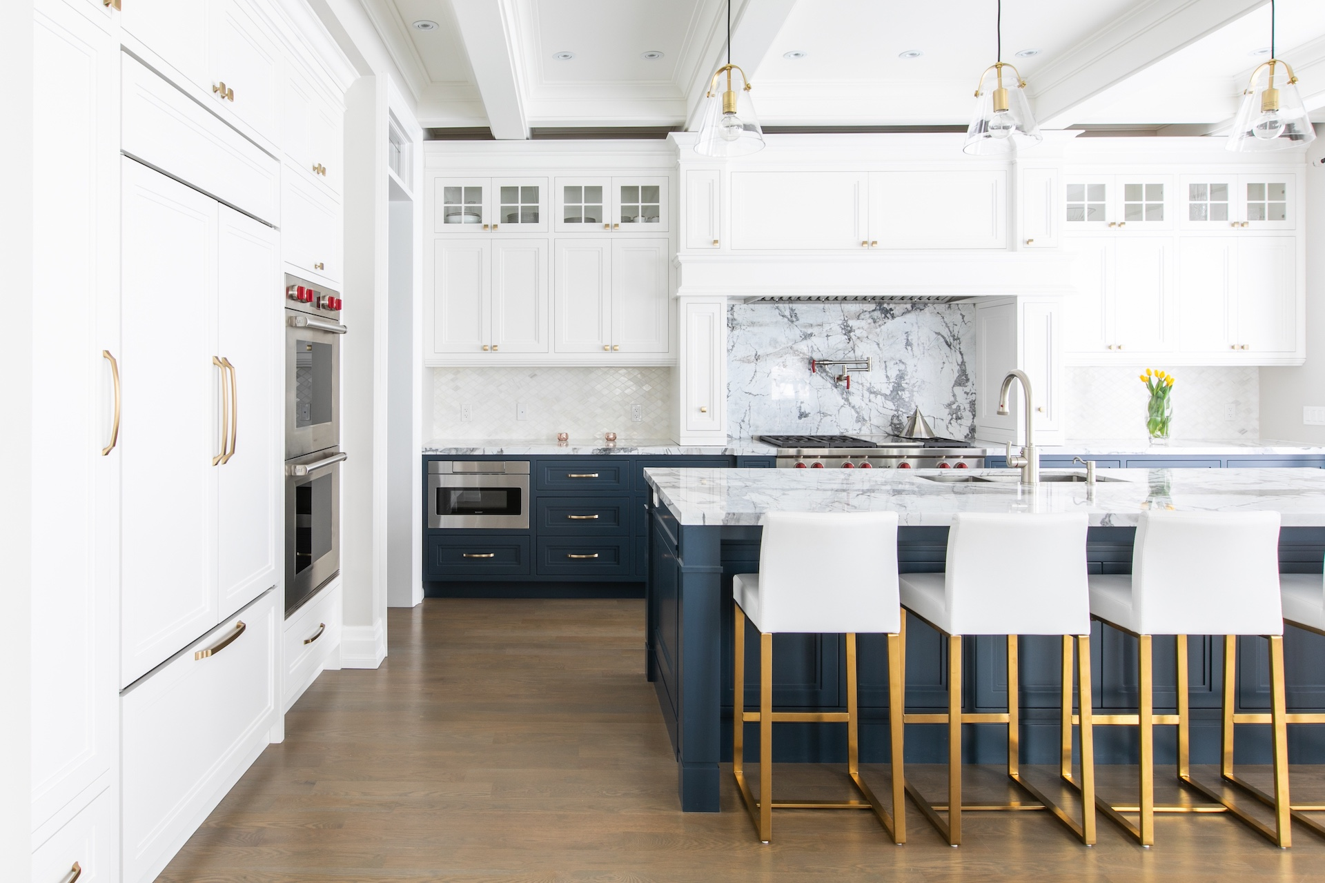 white and blue kitchen with bar stools