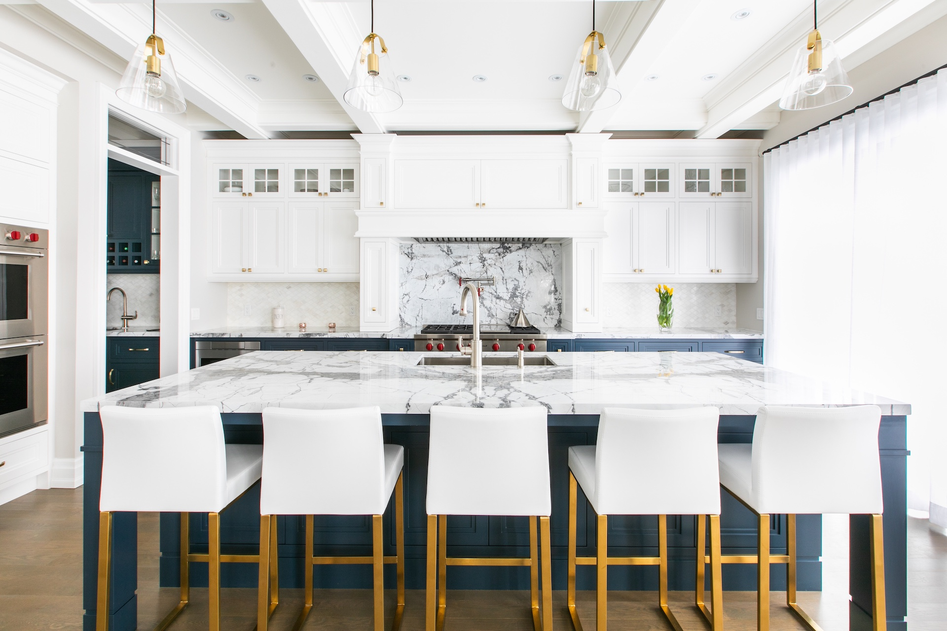 kitchen bar with white and gold stools
